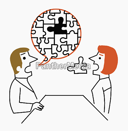 man talking to woman completing jigsaw