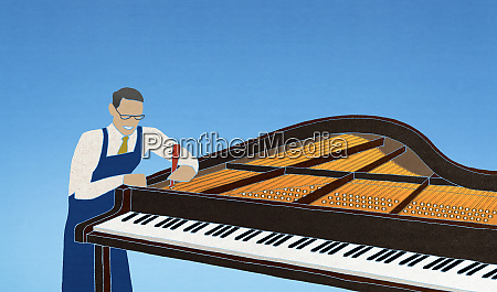 worker tuning piano