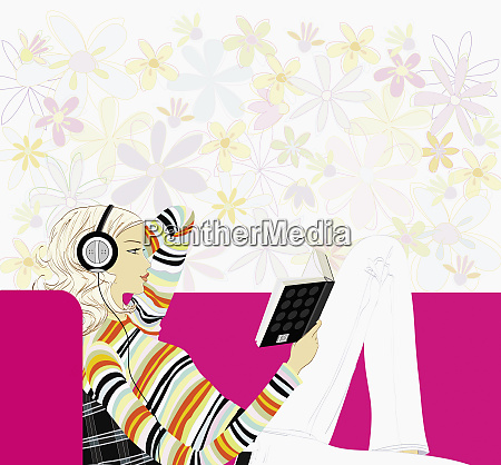 woman listening to headphones and reading