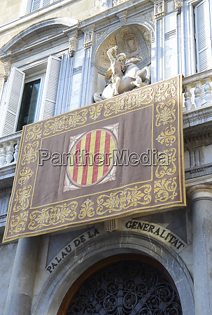 catalan government palace with its flag