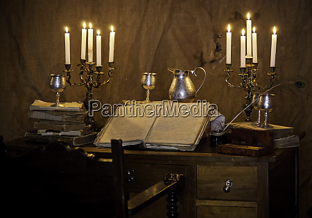 old medieval desk with pen and