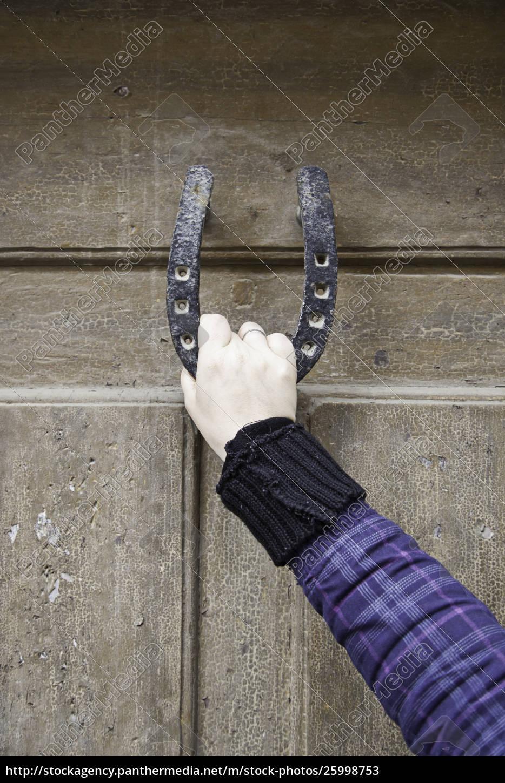 woman, holding, horseshoe - 25998753