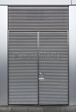 closed metallic grey door with ripples