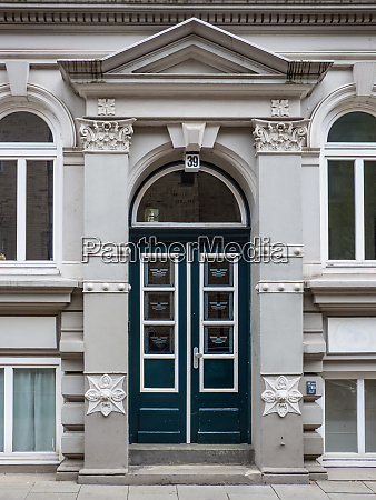 historic double arched door with architrave