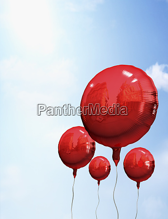 red balloons in sky
