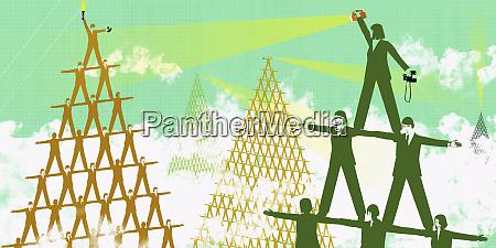 businesspeople balancing on shoulders