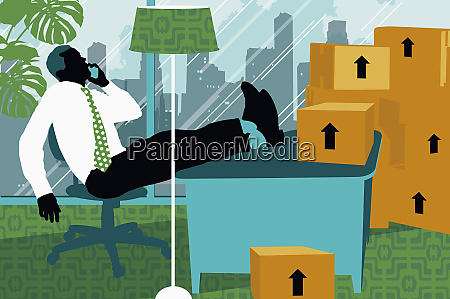 businessman sitting at desk with feet