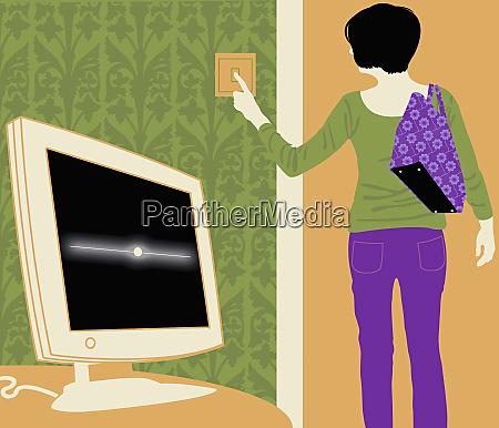 woman turning off light