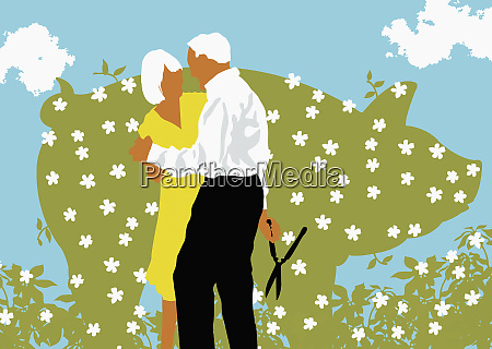 senior couple dancing near blooming hedge