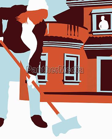man inside house watching wife shovel