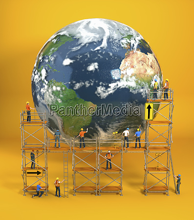 construction workers on scaffold repairing planet