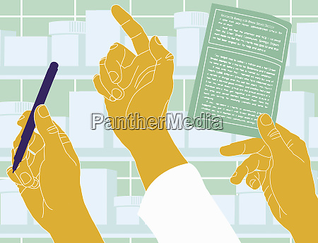 pharmacists hands with pen and prescription