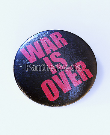 close up of button reading war