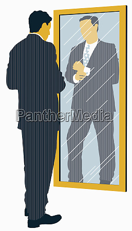 businessman in suit looking at reflection