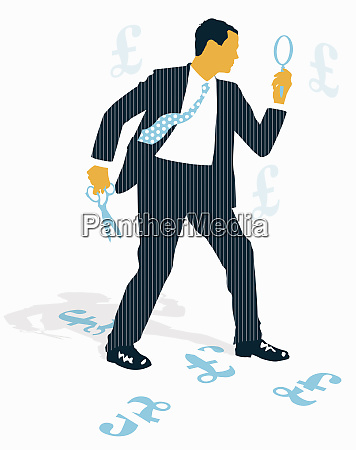businessman with magnifying glass cutting british
