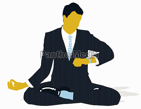 businessman sitting in lotus position and