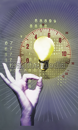 hand turning on light bulb with