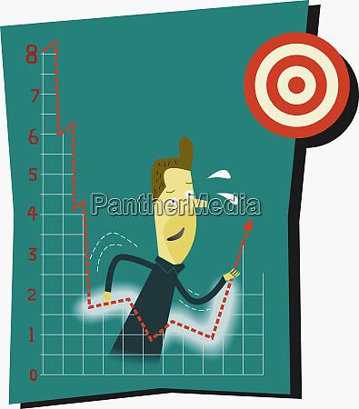 businessman pushing financial graph toward target
