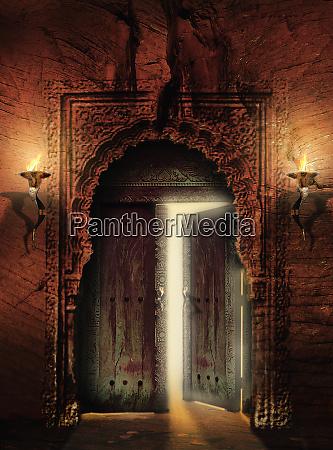 ornate ancient doorway with door partly