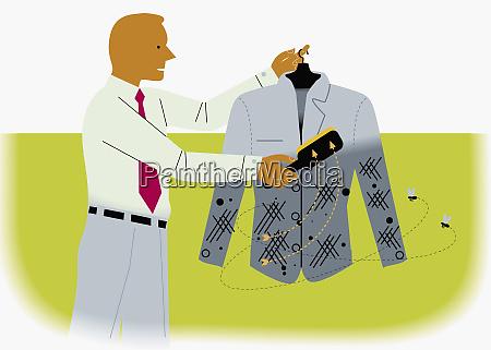 businessman using lint brush on suit