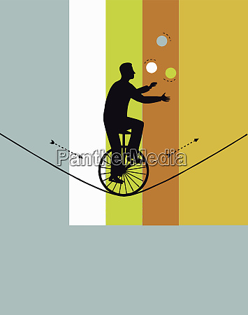 man on unicycle juggling on tightrope
