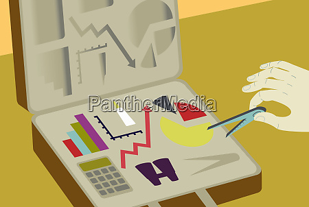 hand taking financial symbols out of