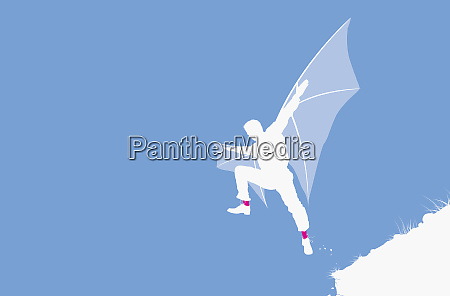 man with wings jumping from cliff