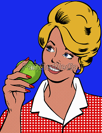 smiling woman eating green apple
