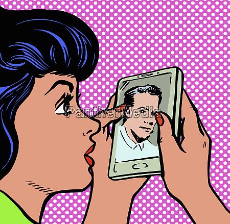 young woman staring at photograph of