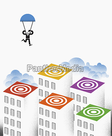 man with parachute landing on colorful