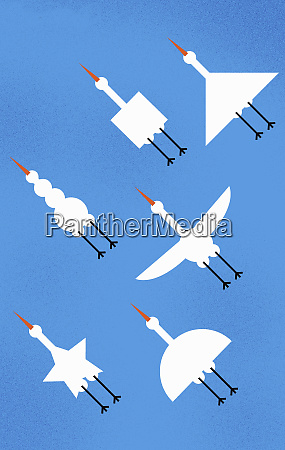 various shaped birds flying in formation