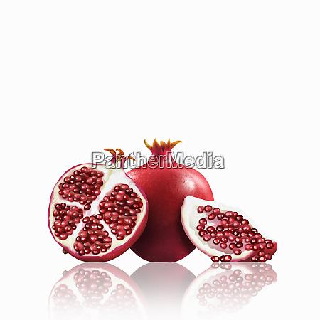 whole and cut pomegranates