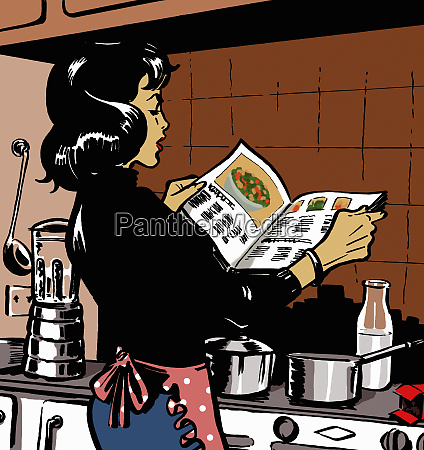 woman reading cookbook in kitchen