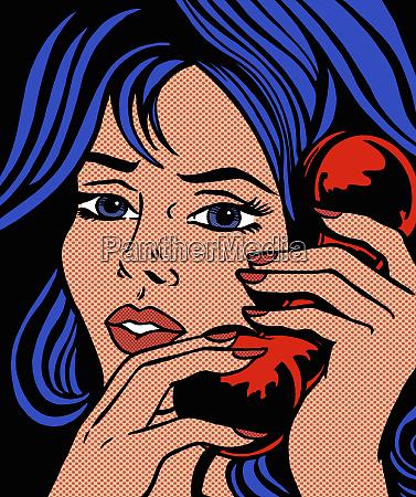 serious woman talking on landline phone