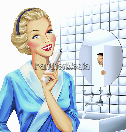 smiling woman holding tube of toothpaste