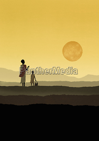 mother and daughter watching sun holding