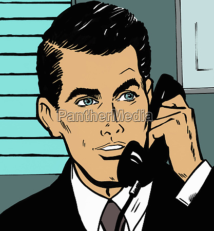 handsome businessman talking on telephone