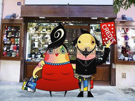 couple with credit card and shopping