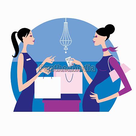 woman handing store clerk credit card