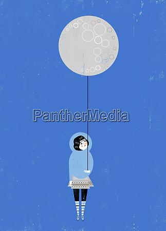 girl holding full moon balloon