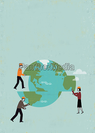business people moving pieces of globe
