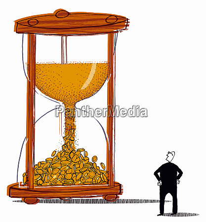 man looking at sand from hourglass