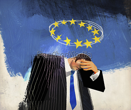sad businessman below european union flag