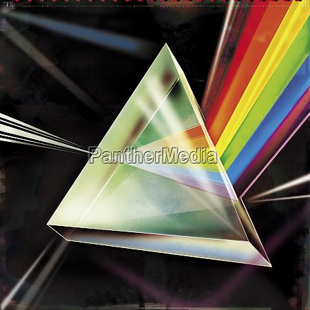 light beam refracting into multicolored spectrum