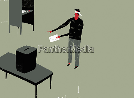 man wearing blindfold holding voting paper