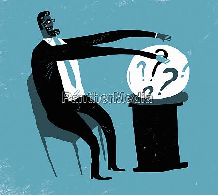 businessman predicting future using crystal ball
