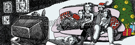 family watching television together at christmas