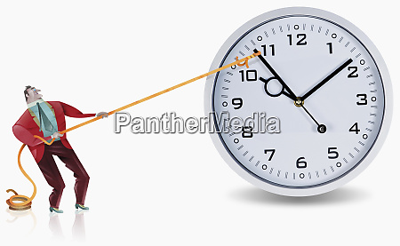 businessman roping clock hand