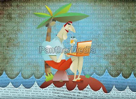 man using laptop on tropical island