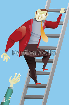 businessman helping colleague climb ladder